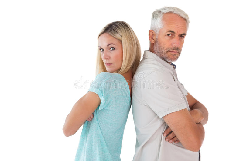 Unhappy couple not speaking to each other. On white background royalty free stock photos