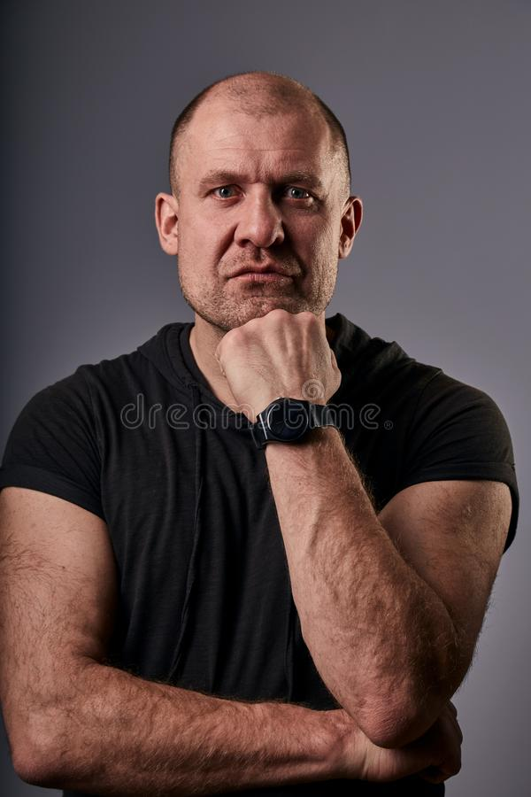 Unhappy depressed man with very sad eyes looking with hand under the face. Closeup portrait of russian actor royalty free stock image
