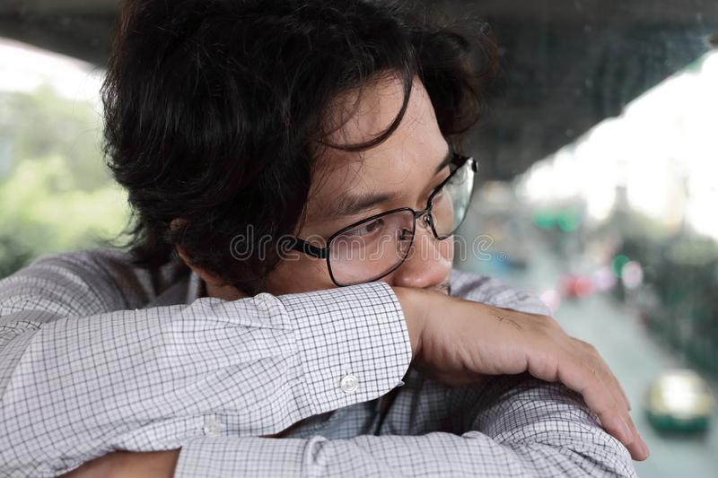 Unhappy depressed young Asian man feeling bad royalty free stock image