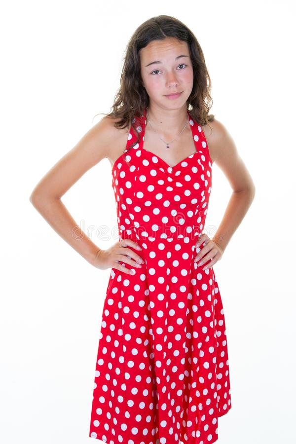 Unhappy dissatisfied young woman in red summer dress standing teen girl feels disappointed isolated over white background stock images