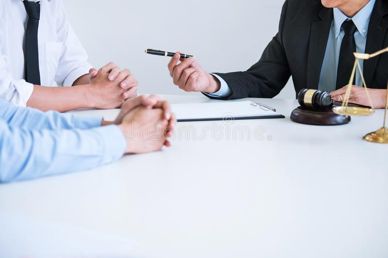 Unhappy divorce couple having conflict, husband and wife during. Divorce process with senior male lawyer or counselor and couple signing decree of divorce royalty free stock images