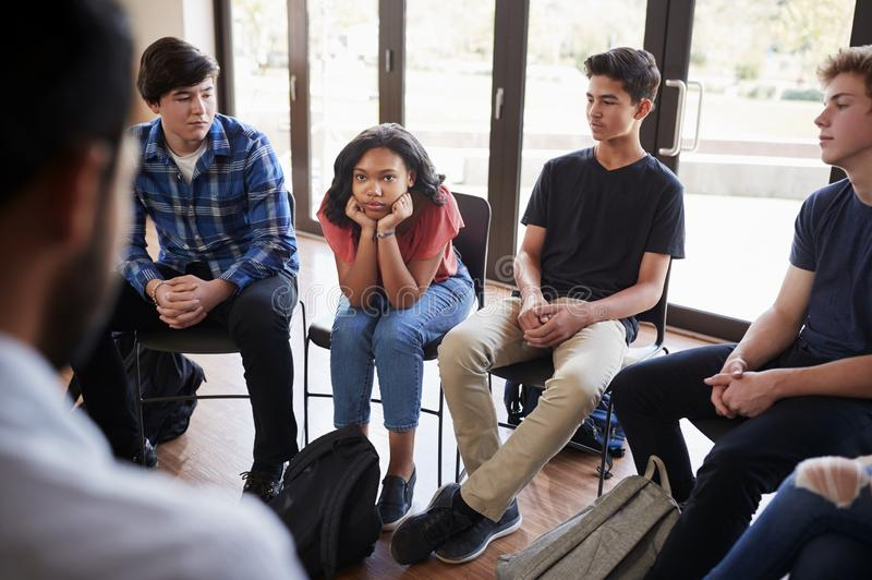 Unhappy Female Pupil In High School Discussion Group stock photography