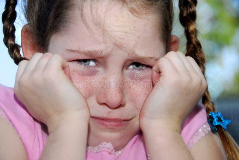 Unhappy freckle faced girl stock image