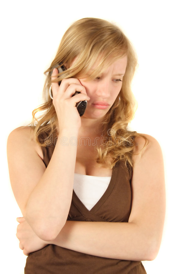 Unhappy girl phoning royalty free stock photography