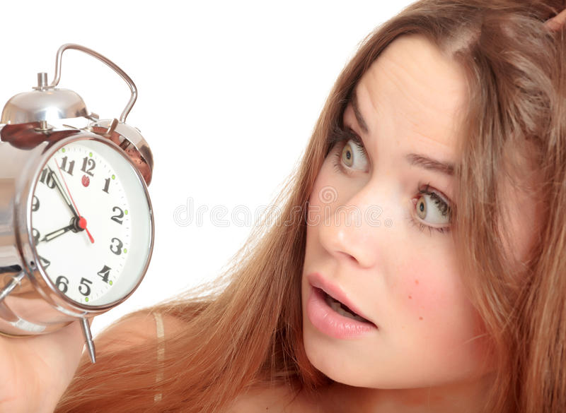 Unhappy girl waking up too late stock photos