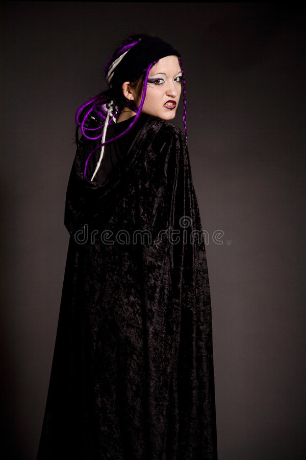 Unhappy gothic. Angry looking gothic woman looking over her shoulder royalty free stock photos
