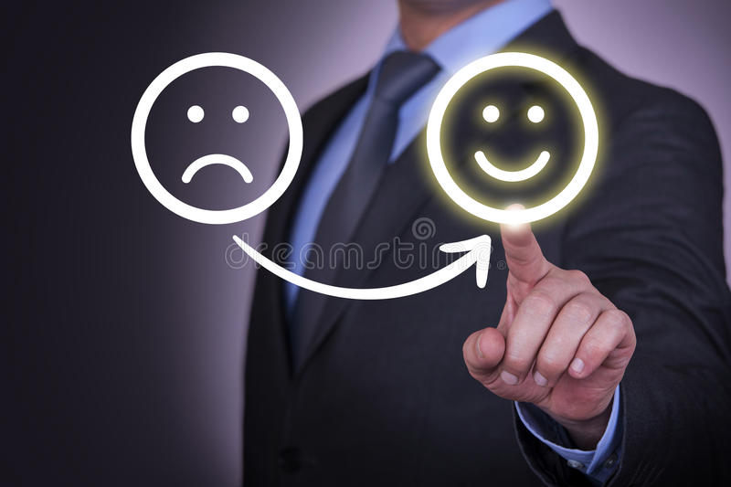 Unhappy and Happy Smileys on Visual Screen royalty free stock image