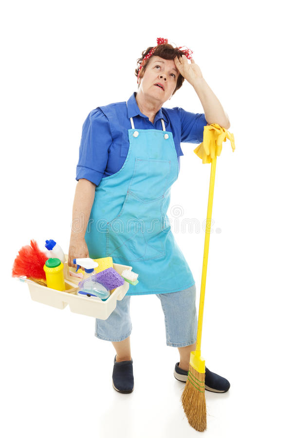 Unhappy Housekeeper. Tired, miserable housekeeper. Full body isolated on white royalty free stock photography