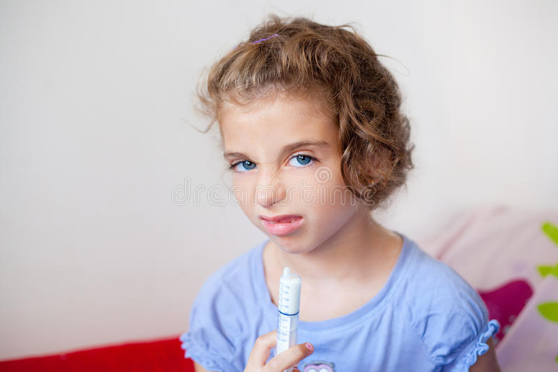 Download Unhappy Kid Girl With Syringe Medicine Dose Stock Image - Image: 21477001