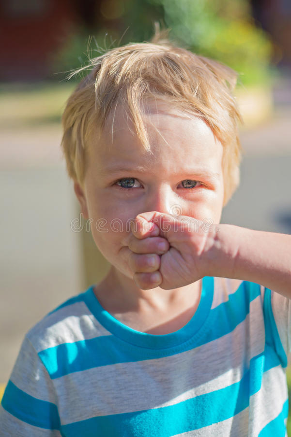 Unhappy little boy stock image