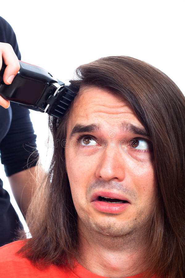 Unhappy Man Being Shaved With Hair Trimmer Stock Photography