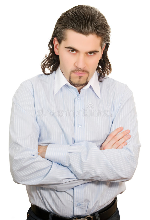 Unhappy man with hands folded at chest isolated stock photo