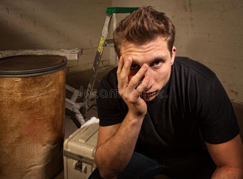 Unhappy Man Sitting royalty free stock images