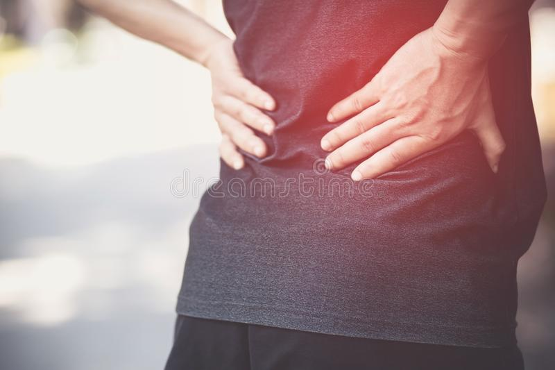 unhappy man suffering from Sport injury while exercise royalty free stock photography