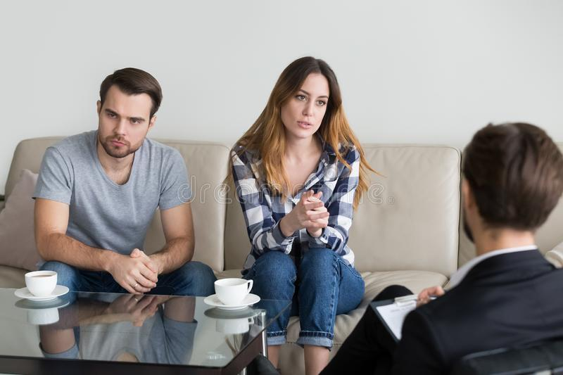 Unhappy married couple counseling, woman talking to psychologist. Unhappy married couple counseling, women talking to psychologist complaining on bad stock image