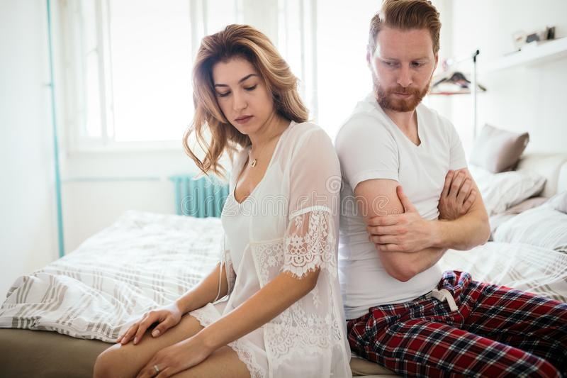 Unhappy married couple on verge of divorce due to impotence stock image