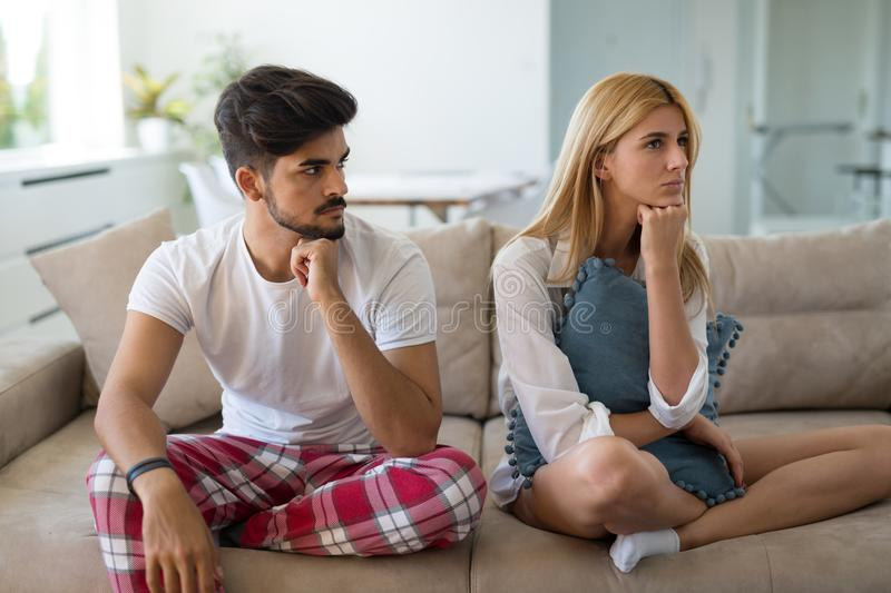 Unhappy married couple on verge of divorce due to impotence stock photography