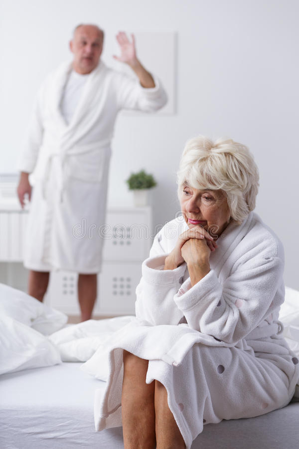 Unhappy mature married couple stock image