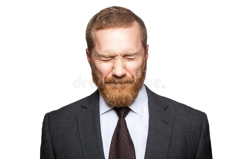 Unhappy sad businessman with closed eyes. stock photo