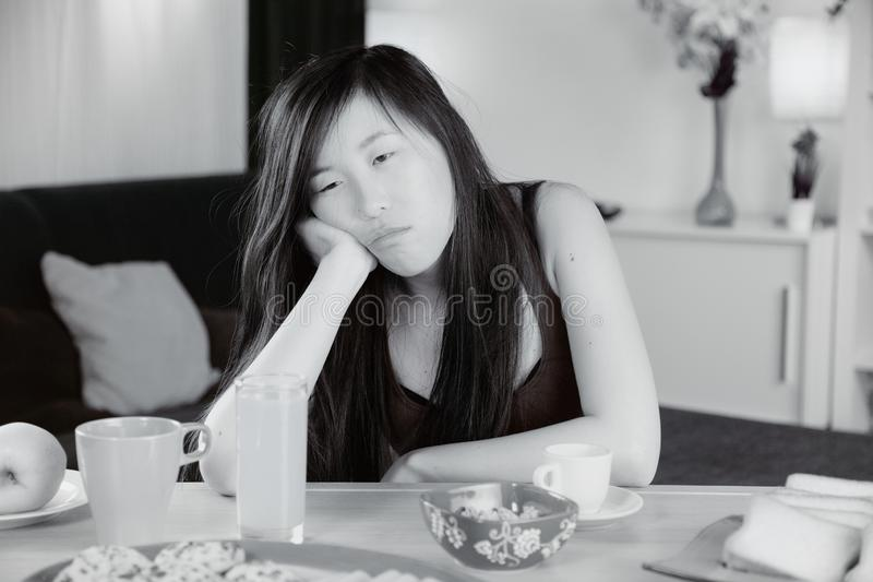 Unhappy sad Chinese woman tired at home stock photography