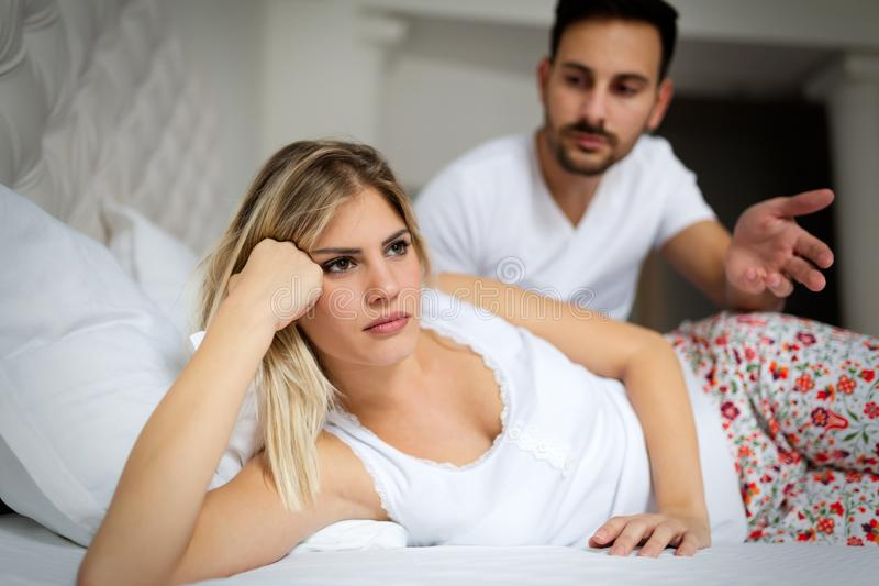 Unhappy young couple having unsolved relationship problems royalty free stock image