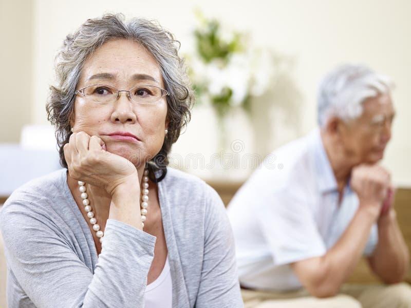 Unhappy senior asian couple royalty free stock images