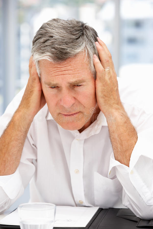 Unhappy senior businessman royalty free stock photo