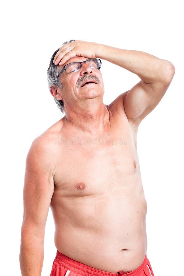 Unhappy Senior Man With Headache Royalty Free Stock Photography