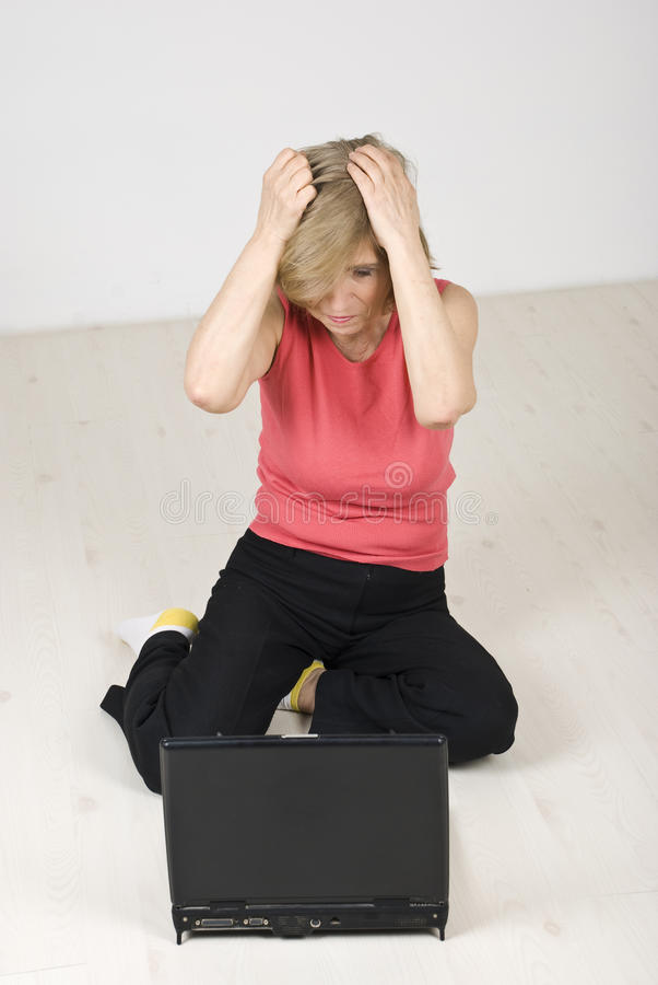 Download Unhappy Senior Woman Using Laptop Stock Image - Image: 14034735