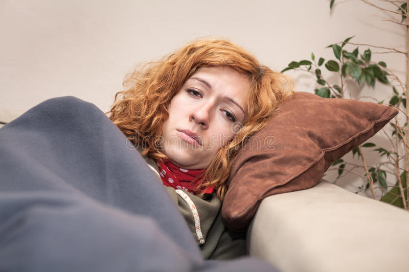 Unhappy tired woman resting at home stock photography