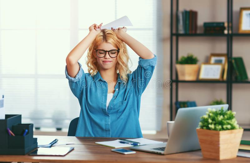 Unhappy tired     business woman in stress   at home office working on computer stock photography