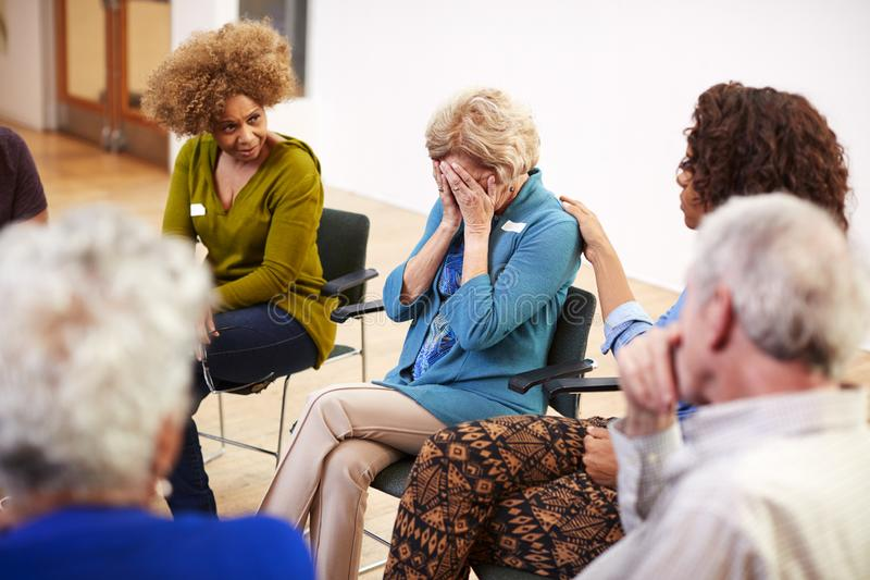 Unhappy Woman Attending Self Help Therapy Group Meeting In Community Center royalty free stock photo
