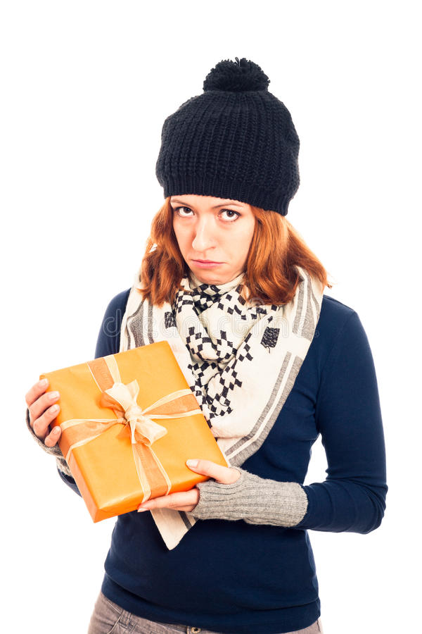 Unhappy woman with gift box royalty free stock photo