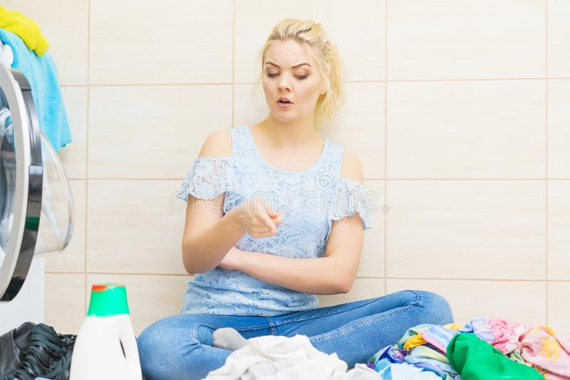Unhappy woman having a lot of laundry stock images