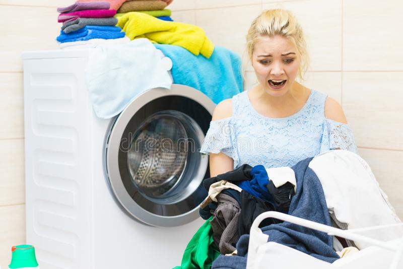 Unhappy woman having a lot of laundry royalty free stock images