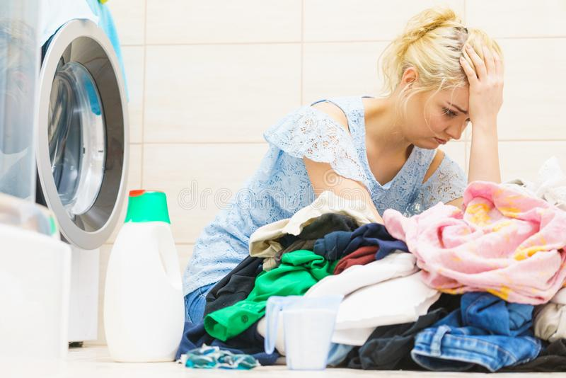 Unhappy woman having a lot of laundry royalty free stock photos
