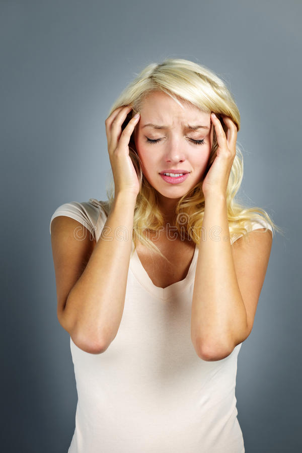 Download Unhappy Woman Holding Her Head Stock Photo - Image of eyes, migraine: 21902642