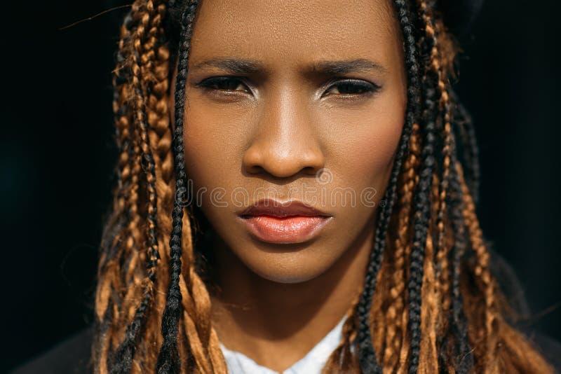 Unhappy woman portrait. Sad black female stock photos