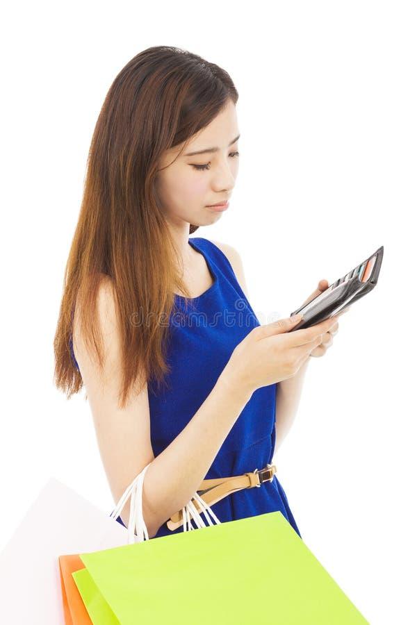 Unhappy woman is so sad to check wallet. Over white stock photos