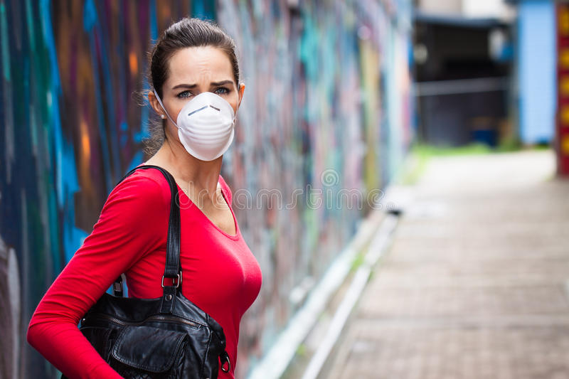 Unhappy woman wearing face mask royalty free stock photo