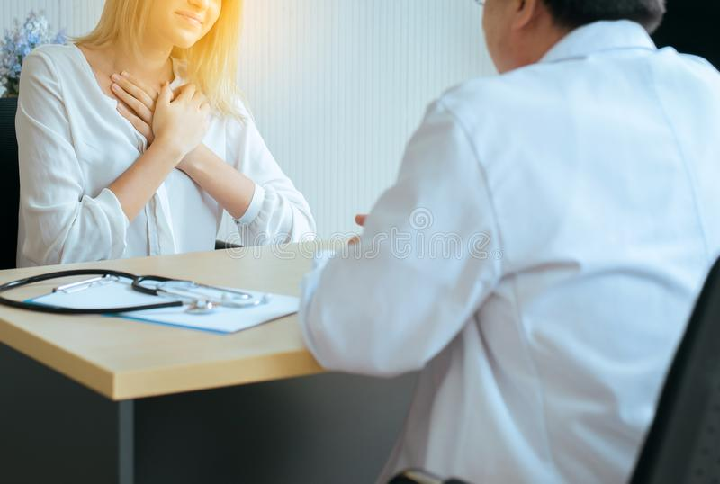 Unhappy woman talking problems to doctor psychiatrist in hospital,Discuss issue and find solutions to,Mental health concept. Unhappy women talking problems to royalty free stock images