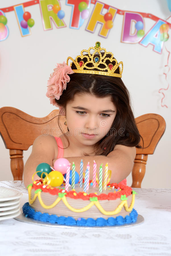 Unhappy young birthday girl child stock image