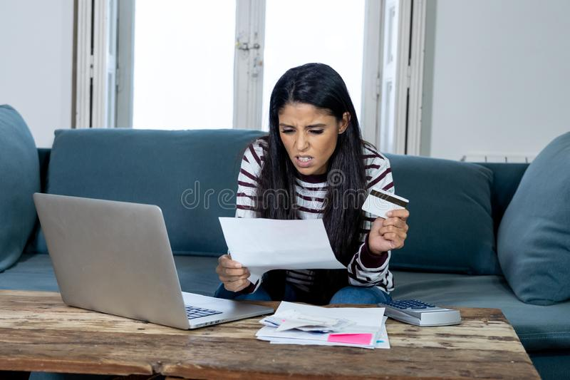 Unhappy young female in stress banking and accounting debt bill bank papers expenses and payments royalty free stock photo