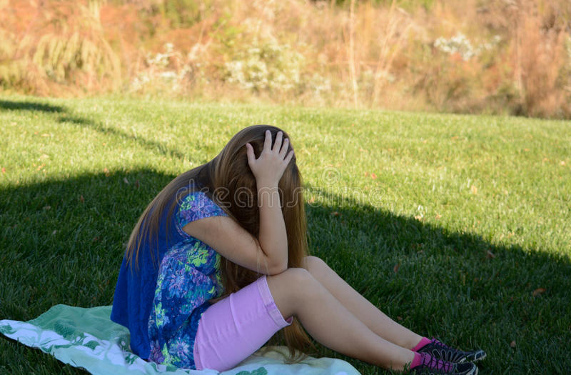 Unhappy young girl. royalty free stock photography