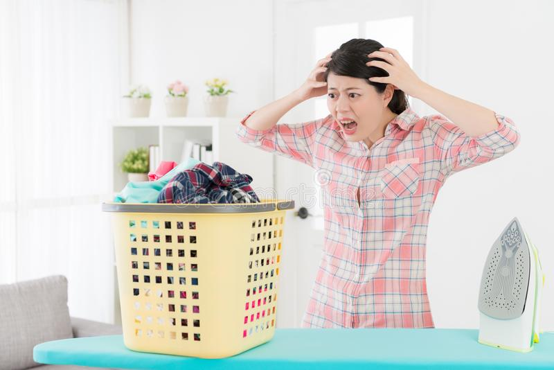 Unhappy young housewife showing shocked emotional royalty free stock photography