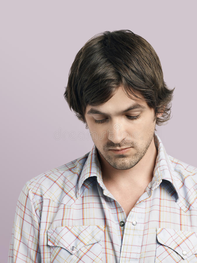 Download Unhappy Young Man Looking Down Stock Image - Image: 33904183