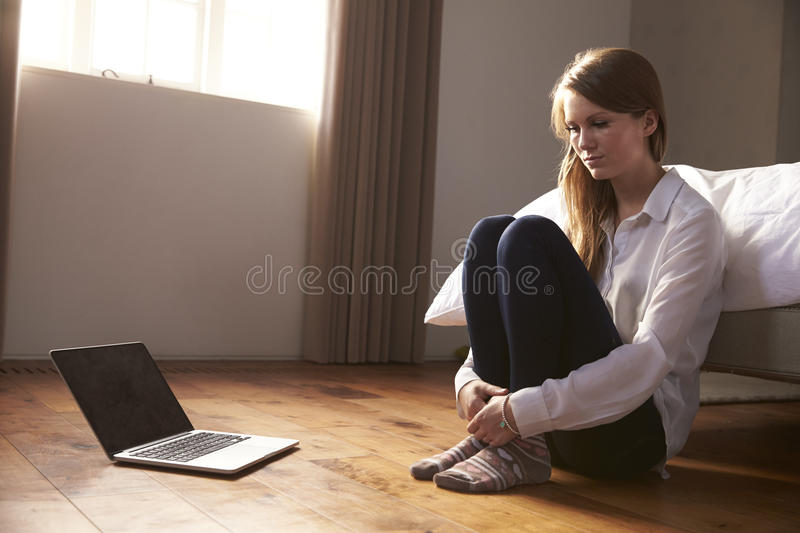Unhappy Young Woman Being Bullied Online With Laptop royalty free stock images