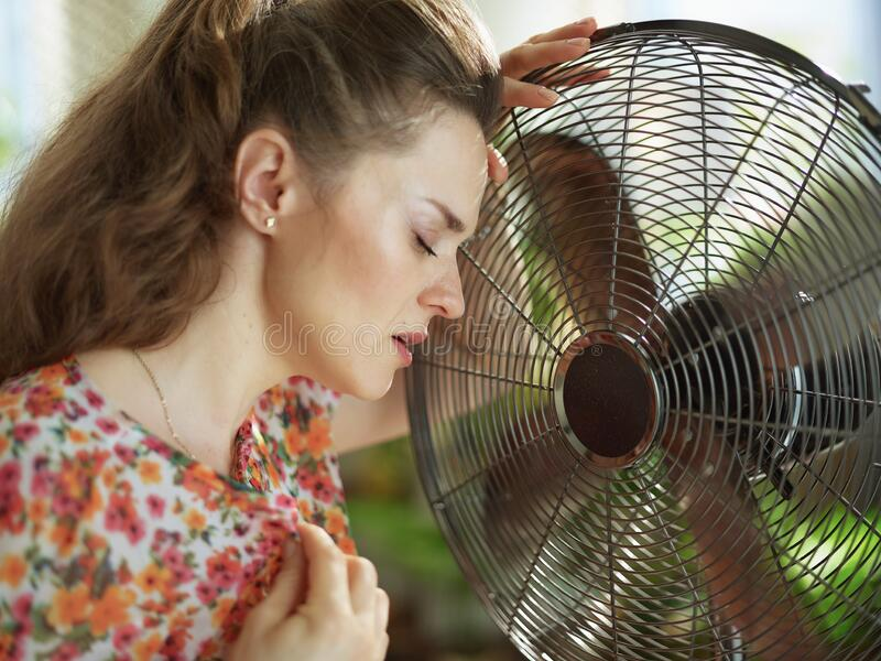 Unhappy young woman feeling summer heat royalty free stock photos