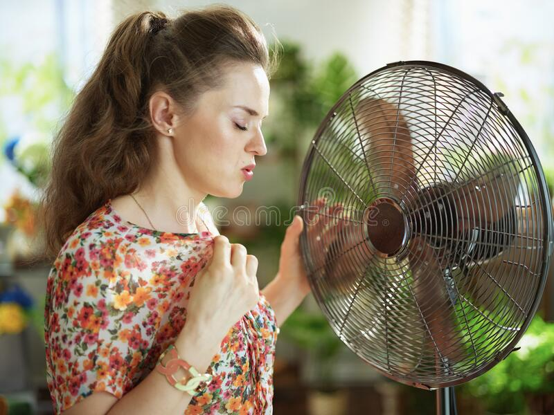 Unhappy young 40 years old housewife feeling summer heat stock images