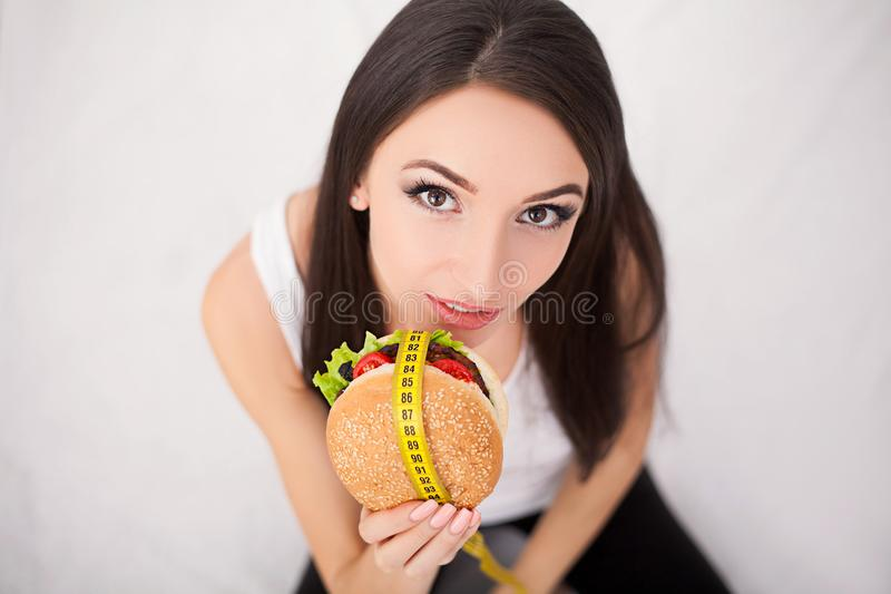 Unhealthy eating. Junk food concept. Girl don`t eat junk food.  royalty free stock images
